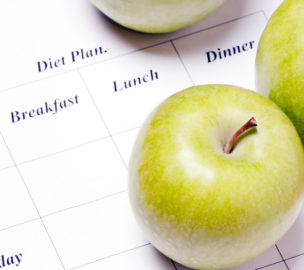 diet plan.  green apples are on the diet plan, shallow depth of field.  focus on the apple.